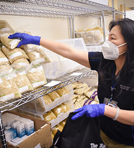 Caregiver shops in the commissary UCI Health created for its healthcare workers amid the novel coronavirus pandemic.