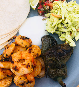 Grilled shrimp tacos with avocado slaw