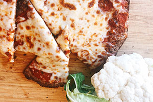 A cauliflower crust lightens up the calorie count of pizza but not the flavor.