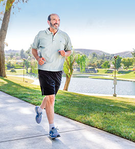 UCI Health glioblastoma survivor Daniel Boyd takes his daily run in Chino Hills.