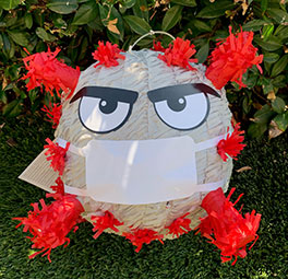 UCI Health family medicine practitioner Dr. Jose Mayorga and his family plan to celebrate Halloween by swatting this coronavirus pinata.
