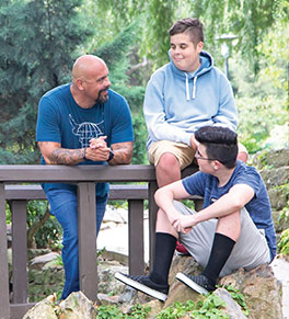 Anaheim paramedic captain Joe Aldecoa, who has battled back from a severe case of COVID-19, enjoys park time with sons Ethan and Ryan.