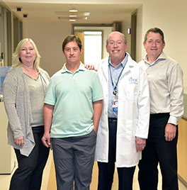 UCI neurosciences researcher Elizabeth Head, PhD, research participant Jeremy Throckmorton, Dr. Ira Lott and Eric Doran are studying the connection between Alzheimer's disease and Down syndrome.