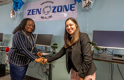 Kim Payne, director of the UCI Health Patient Access Center, and Dr. Nasim Afsar, director of Ambulatory Services, introduce the Zen-Zone standing work stations on Dec. 19, 2018.
