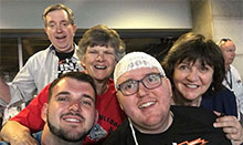Brain tumor patient Joe Smeeding and his family at the NCAA Mens basketball Final Four game