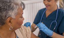 woman getting shingles vaccine